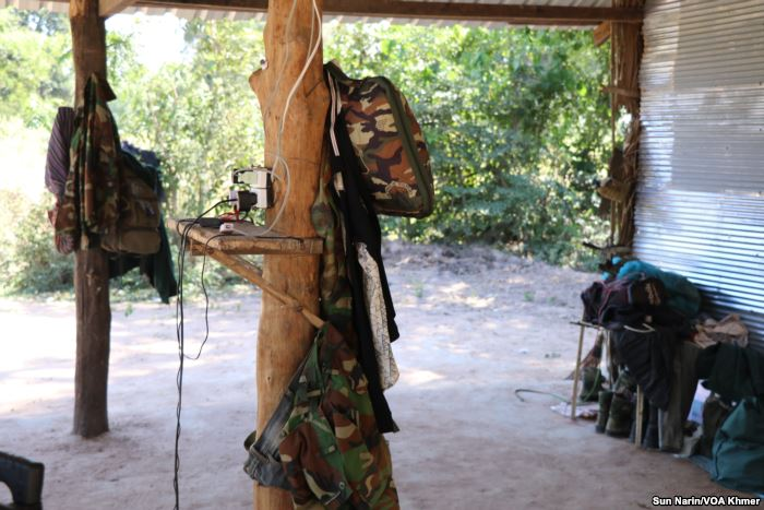 Camouflage uniforms and accessories hang inside the makeshift base camp in Tram Sasar commune of Srey Snam district on Dec. 21, 2017
