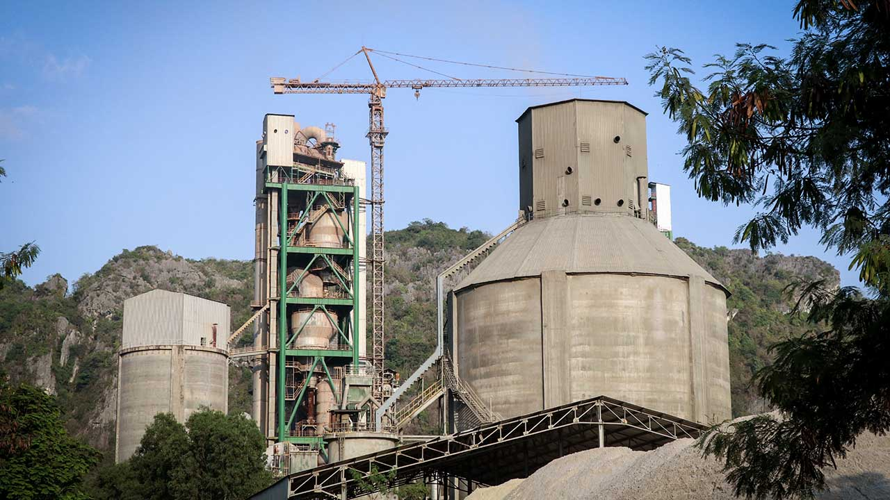 Kampot Cement Factory is seen at the foothill of Totung Mountain