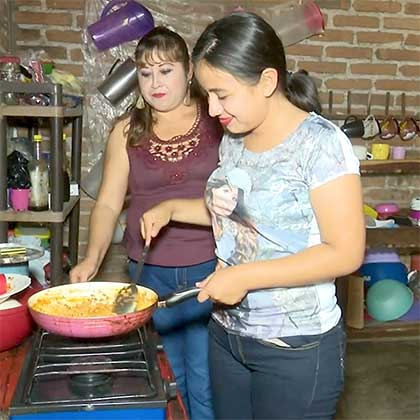 Photo of Estrella cooking with her mother-in-law.