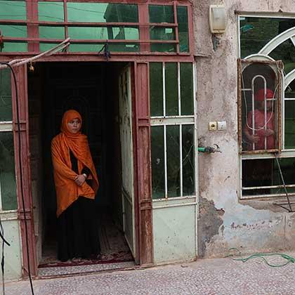Photo of Somaya standing in a doorway