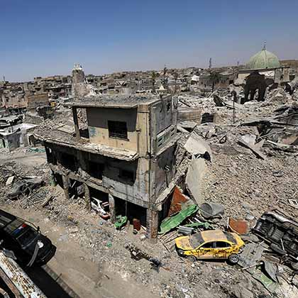 Intense fighting destroyed the Old City of Mosul, where the remains of the Grand al-Nuri Mosque and al-Hadba minaret can be seen, in Mosul, Iraq, Aug. 5, 2017.