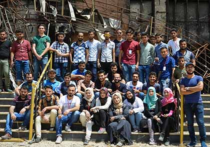 A group of some of the Mosul youth who volunteered to rescue thousands of books among the destruction of Mosul University's Central Library.