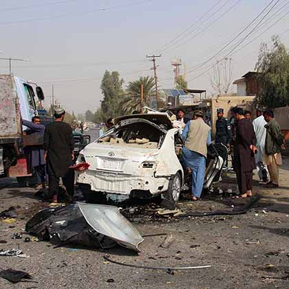 The wreckage of a car carrying Radio Free Europe/Radio Liberty reporter Elyas Dayee is seen in Lashkar Gar, Helmand province, on November 12, 2020, after a sticky bomb detonated, killing the popular journalist.