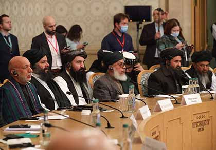 Former Afghan President Hamid Karzai, left, and Taliban co-founder Mullah Abdul Ghani Baradar, second from right, attend an international conference for a peaceful solution to the conflict in Afghanistan, hosted in Moscow in March 2021.