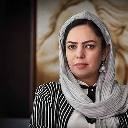 Portrait photograph of news anchor Anisa Shaheed